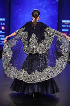 Royal blue velvet hand embroidered cape with dupion silk lehenga