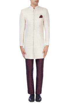 Ivory sherwani with wine trousers