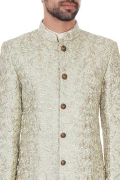 Light green silk jaal & zari embroiered sherwani with kurta & churidar
