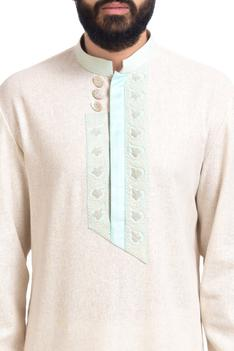 Off-white matka silk embroidered kurta with churidar