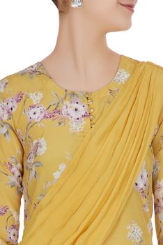 Floral printed tunic with draped layers.