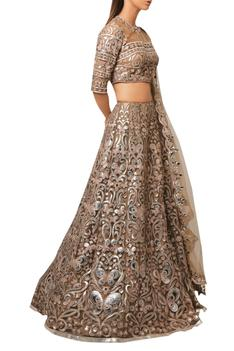 Brown net leather patch embroidered lehenga & blouse.