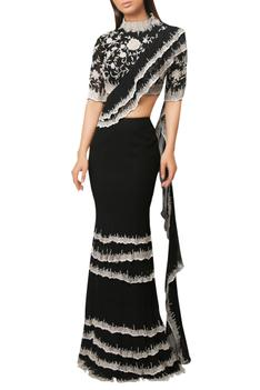 Midnight black draped saree with layered skirt and peplum blouse