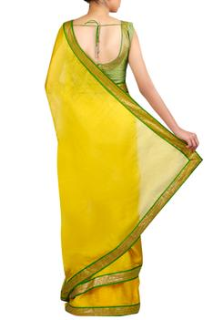 Sequin border embroidered saree with sleeveless blouse