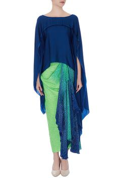 Navy blue asymmetric top with green draped skirt