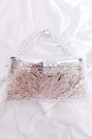 A Clutch Story Embossed Flap Metal Clutch