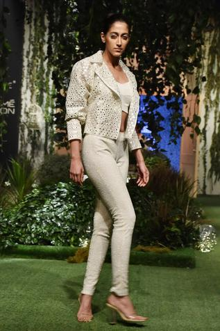 Pale ivory honeycomb embroidered pants