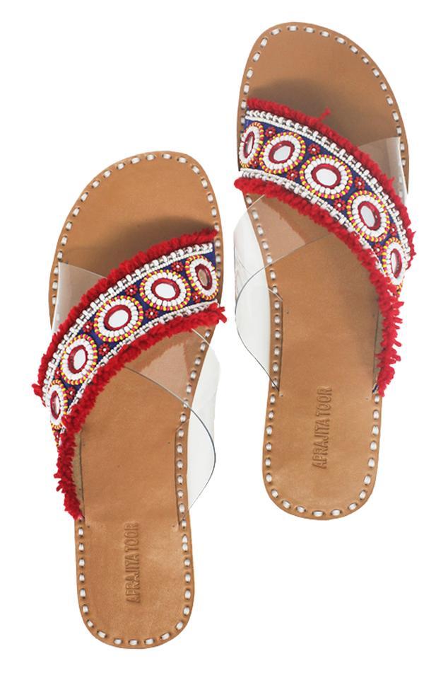 Red tassel & bead embellished criss-cross sandals