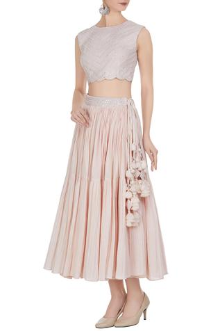 Embroidered crop top with short tiered pleated skirt.