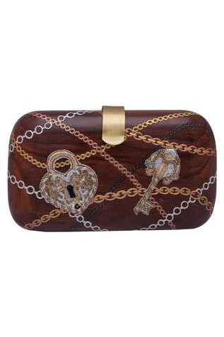 Hand embroidered motif clutch