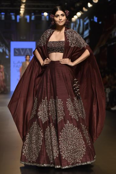 Embellished lehenga with long cape and bustier