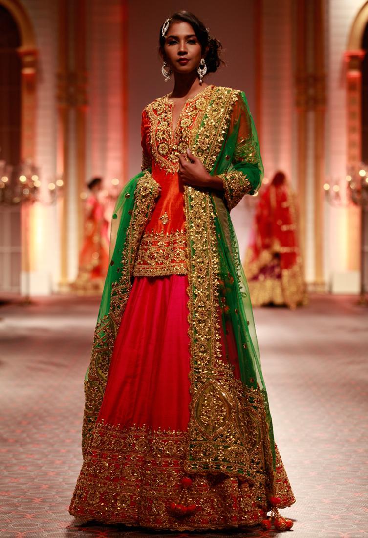 Orange embroidered kurta with pink lehenga & green dupatta