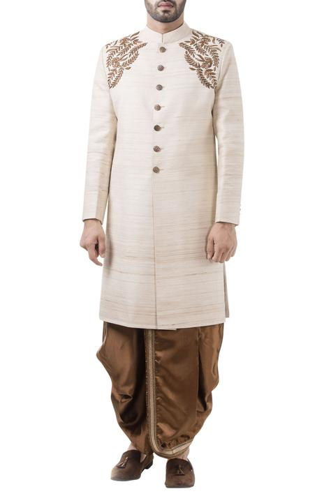 Beige silk embroidered sherwani with rust dhoti pants