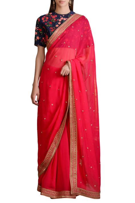 Navy blue floral blouse with pink georgette saree